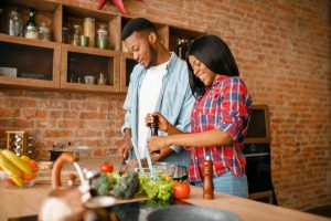 couple cooking healthy food | MyPowerLife